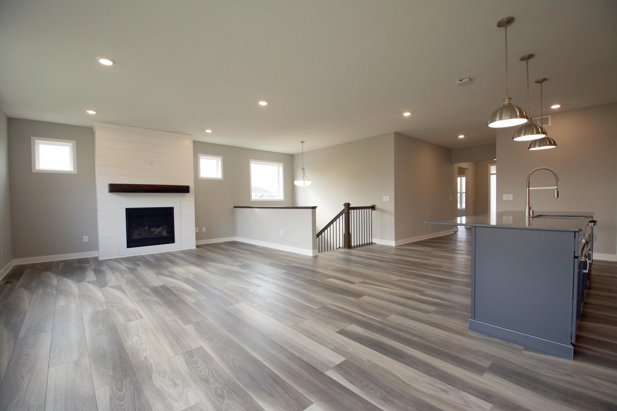 Welcome! Enjoy this amazing 3 bdrm home that has so much to offer! The stately features, including the upgraded plank flooring that is tolerant to water & scratches, along w/the shiplap fireplace & beautiful homesite allows this home to shine.
