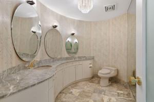 Main floor marble bath located in the foyer.