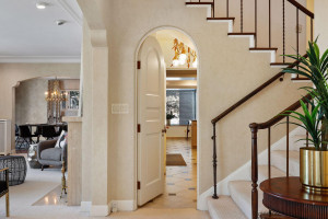 Beautiful, mediterranean details make up this second stair way access to upper level and door access to lower level.