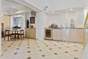 Wet bar is located right off of the kitchen - the ultimate entertaining set up.