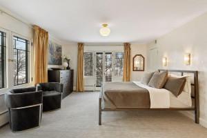 Timeless master suite with juliet french door balcony overlooking Lake Harriet