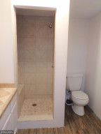 Lower Level 3/4 Bath With New Stone Tile Shower