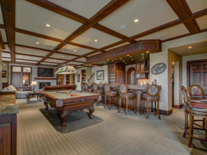 Custom bar with a full kitchen. The lower level is a perfect spot for entertaining