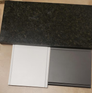 Kitchen cabinet colors for the home under construction: White cabinets, gray center island and black granite.