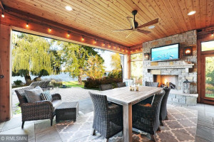 Screened Porch Features a Stoned Gas Fireplace and Phantom Screen