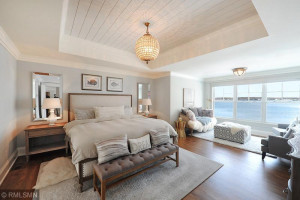 Master Bedroom With Shiplap Detail and Sitting Room