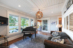 Shiplap Ceiling in Piano Family Room that Opens to Screened Porch