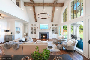 Great Room Ceiling Featuring Reclaimed Beams, Shiplap and Marble Gas Fireplace