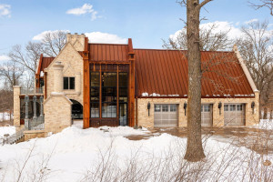 Countless custom features comprise the unique form and function of this home including the solid iron gutters fully integrated within the roof and walls.