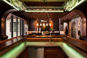 The bar was designed to center around the bartender or mixologist for that inviting pub feel. The custom designed steel stemware rack is a work of art.