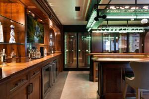 Stunning custom designed bar offers two beverage fridges, ice cube maker, dishwasher and 1,100 bottle wine storage.