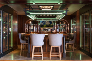 The pub bar is outfitted with LED mood lighting and surrounded by the glass-encased, temperature controlled wine cooler.