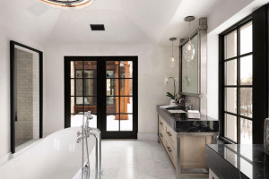 Carrara marble tile surrounds the step-in shower. You will find custom lighting throughout.