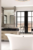 The vanity is a custom-made stainless-steel, wood and granite unit designed right onsite. The medicine cabinet opens by a pulley and hand crank mechanism.