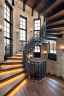 """""""A million dollar staircase."""" Built like a helix, the intricate railing system is not only ornamental but provides support for the entire staircase."""