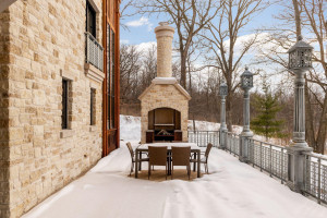 Dine outdoors on this stunning patio with artisan grill. Manually raise and lower the grill over a hot flame with the crank system, enhancing your outdoor grilling experience.