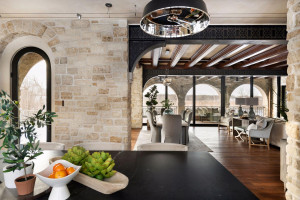 We love the stone arches and handcrafted scrollwork designed into the steel beams, making it a functional work of art.