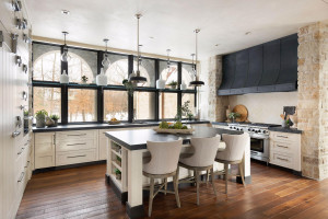 The white-washed custom cabinetry was designed and built by Riverstone, Inc.