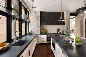 Rich and velvety soapstone countertops adorn this spacious kitchen.