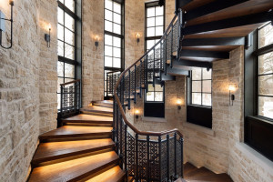 The grand spiral staircase leads to the luxurious upper level owner's suite with sweeping views and two junior ensuite bedrooms.