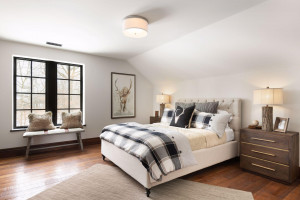 This spacious bedroom features hardwood floors, walk-in closet, three-quarter bath and private views.
