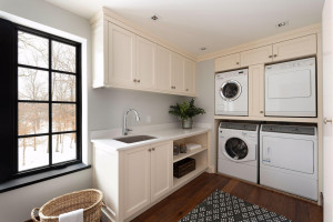 The laundry room is conveniently located on the upper level. This home is also equipped to add an elevator.