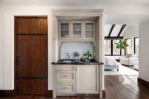 Custom white oak planked interior doors with solid steel cores and straps are found throughout.