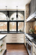 Professional-grade appliances and artistic ironworks range hood is just one the grand elements of this chef-inspired kitchen.