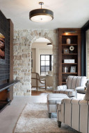 The heated floors of this sitting room are made from polished Indiana limestone.
