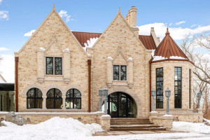 The property announces its presence with solid Saint Croix Valley limestone blocks. Fun fact: 45 truckloads of solid limestone delivered and tumbled onsite to create this incredible masterpiece.