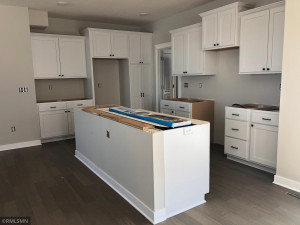 Kitchen with large center island, pantry, and buffet serving counter