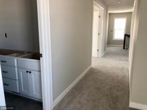Upper hall, master bedroom has French doors