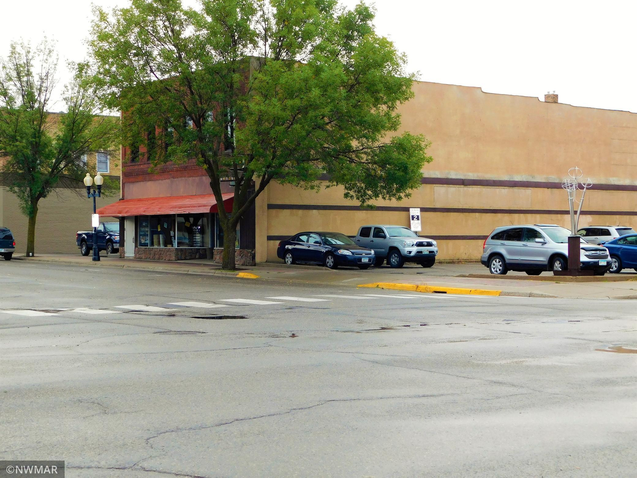 Great Space in Downtown Bemidji with parking lots on both sides of the building