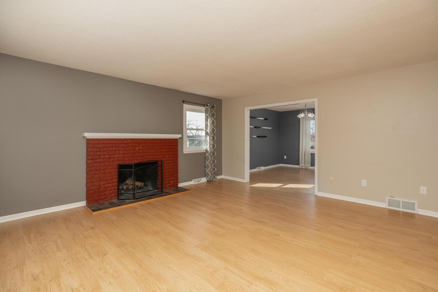 Living Room with real wood burning fireplace