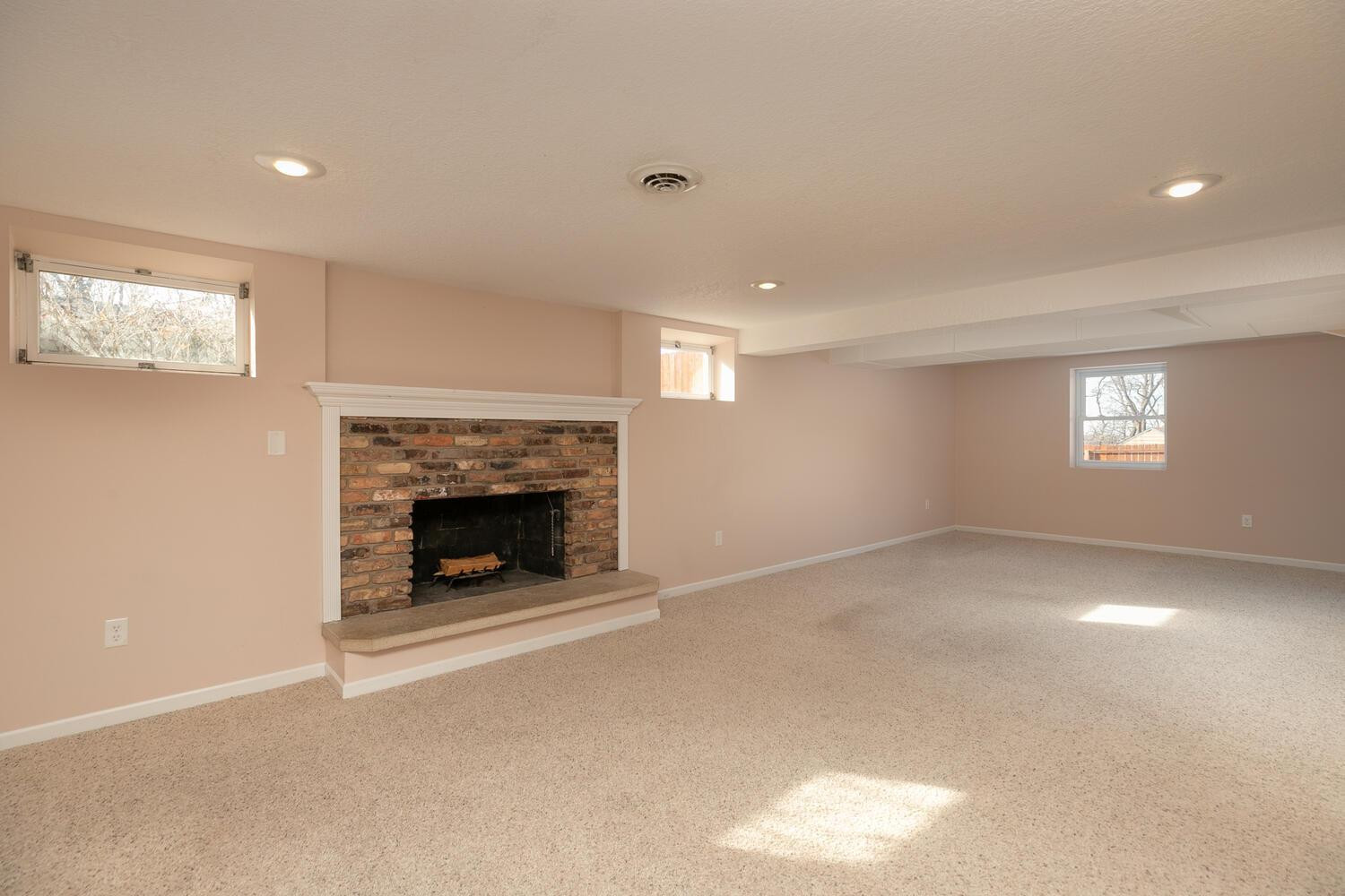 Lower level family room with real wood burning fireplace
