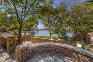 Blue stone patios, Chinese lilac trees, limestone & brick-lined pathways throughout the property.