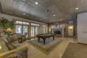 Lakeside family room leads to 1,200 sq ft heated & shaded patio.