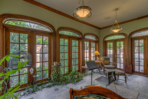 The conservatory overlooks an exterior wall of art custom designed for this property by Allen Roehrig.