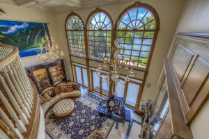 Living room opens to 1,200 sq. ft. lakeside patio with pool.