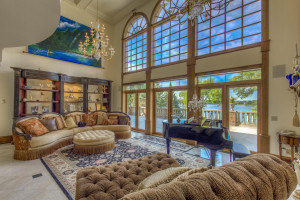 Lakeside & poolside living room with 30+ foot ceiling.