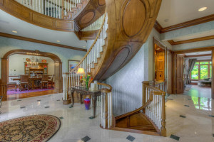 Spectacular floating spiral staircase carries you to all four stories.