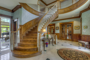 Spacious inviting foyer with marble flooring.