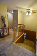 downstairs or hallway to bedrooms and bathrooms
