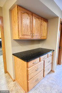 cabinets and granite countertop by garage entrance
