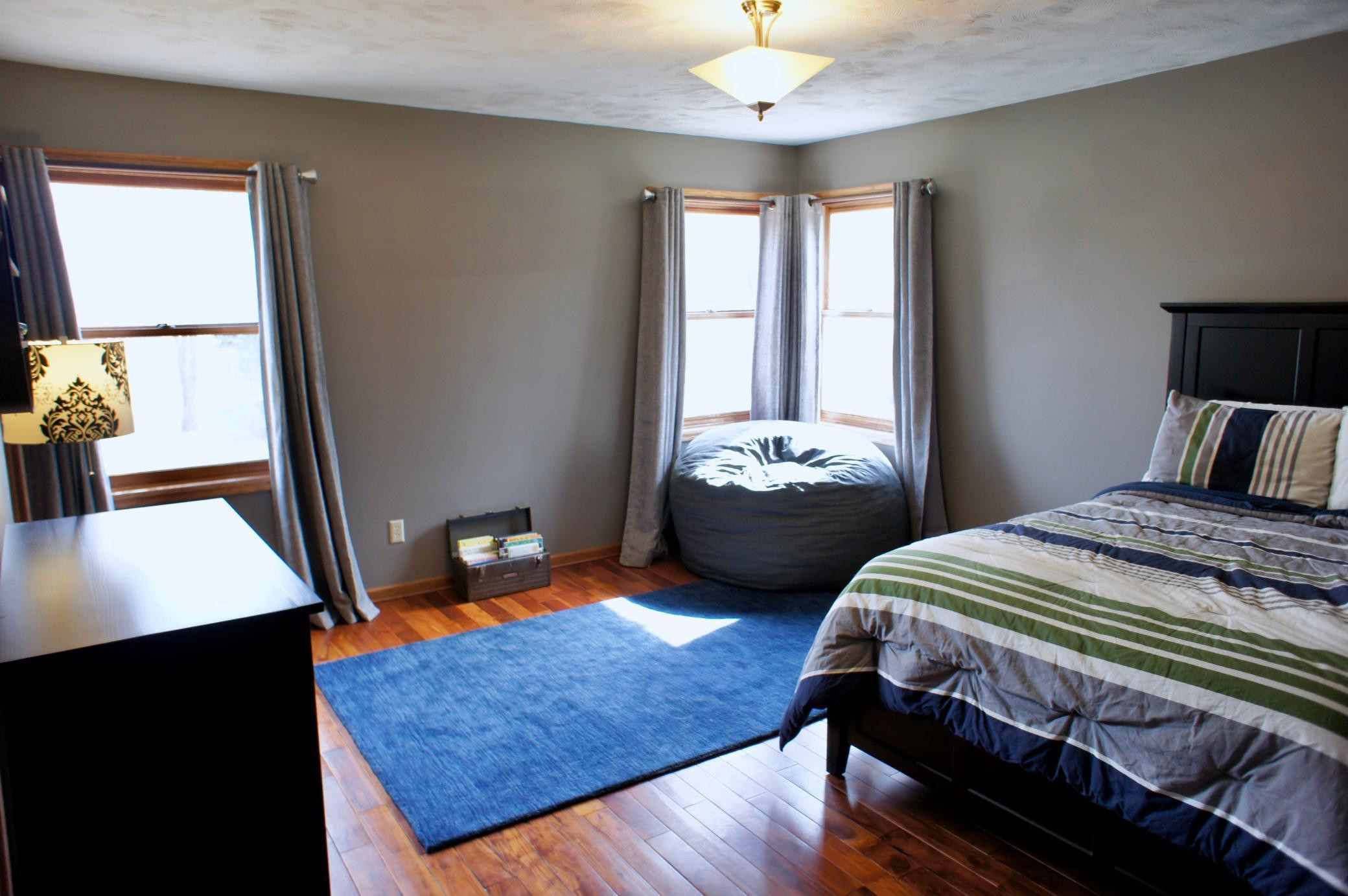 Welcome back to the main level that has its own master sized bedroom with a walk in closet and walk thru bath.
