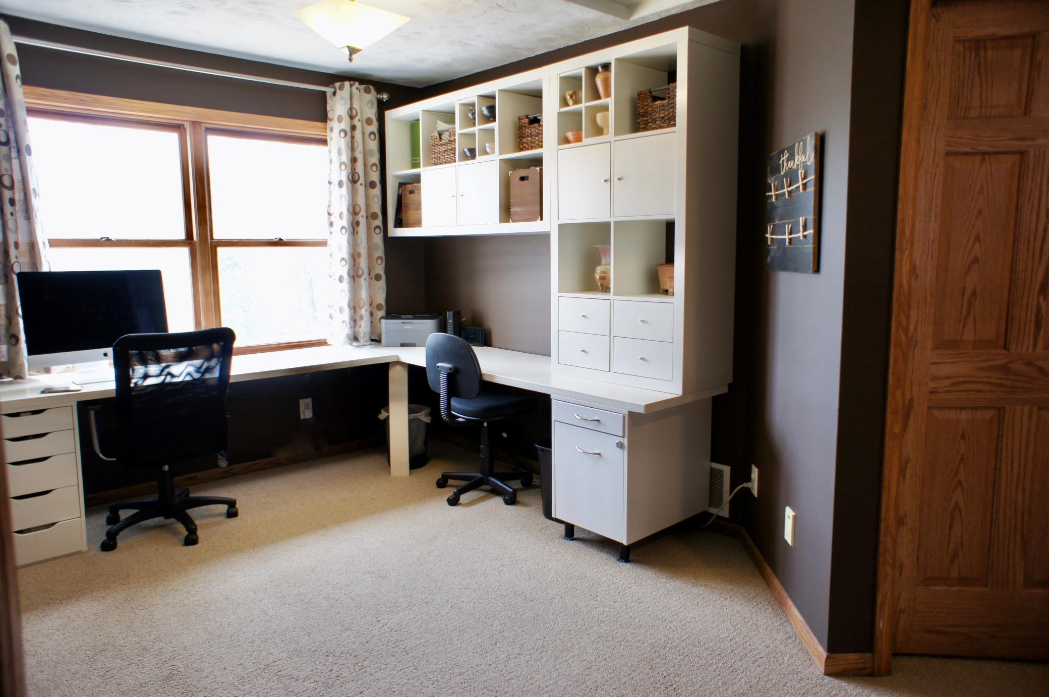 The loft features spacious built in shelving and desk space.