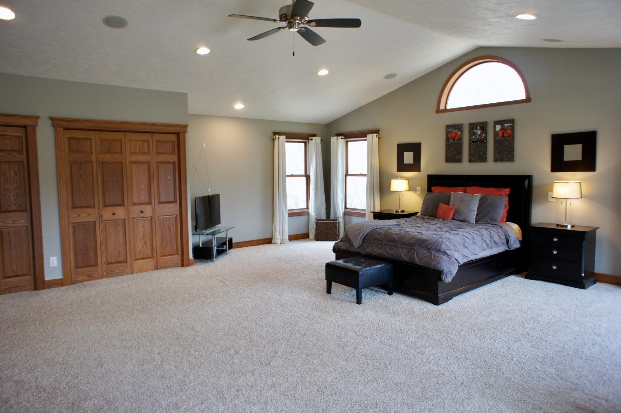 Another view showing the double closets and vaulted ceilings