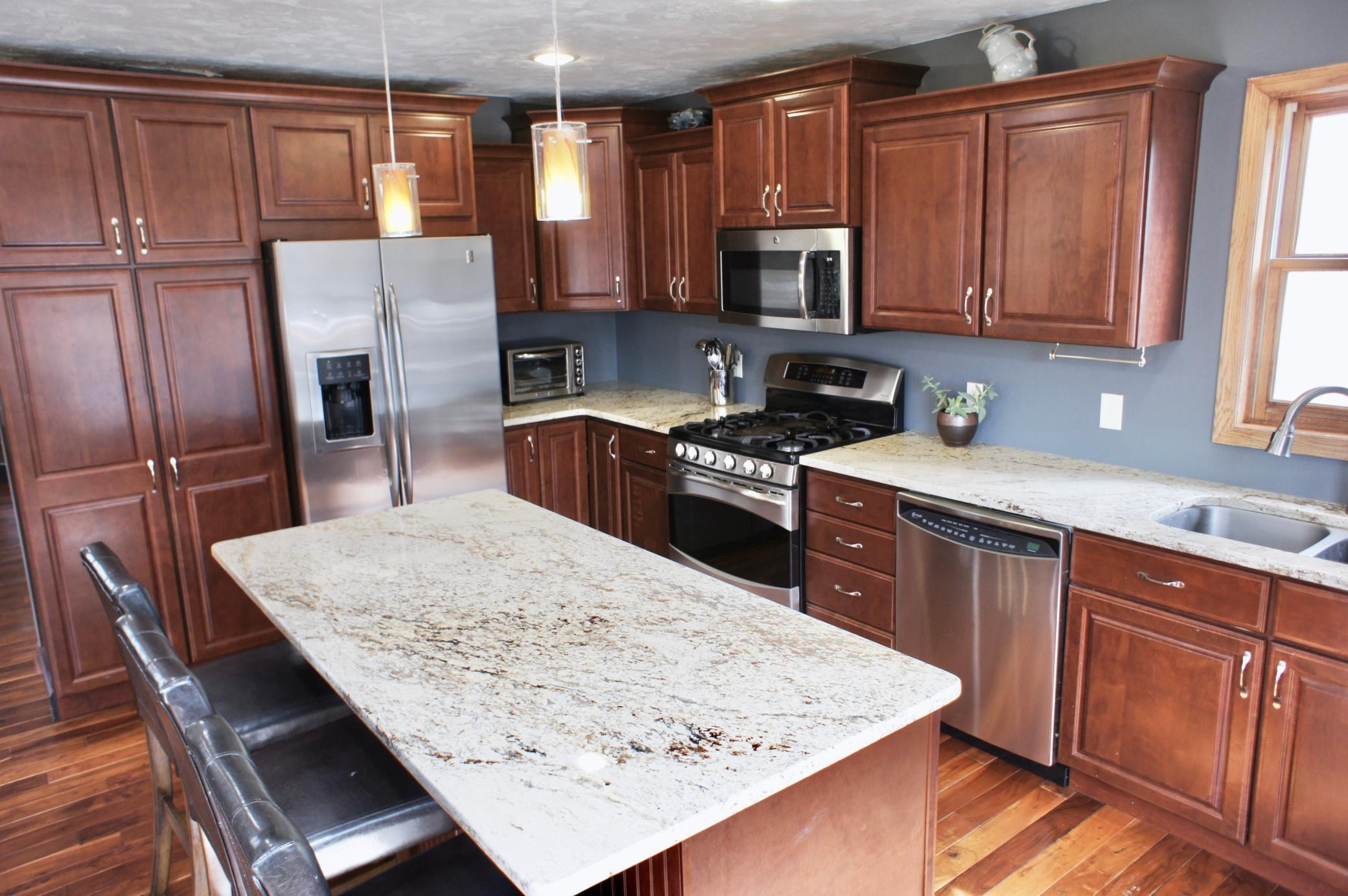 Notice the dual fuel double oven and ample cabinetry including the floor to ceiling pantry.