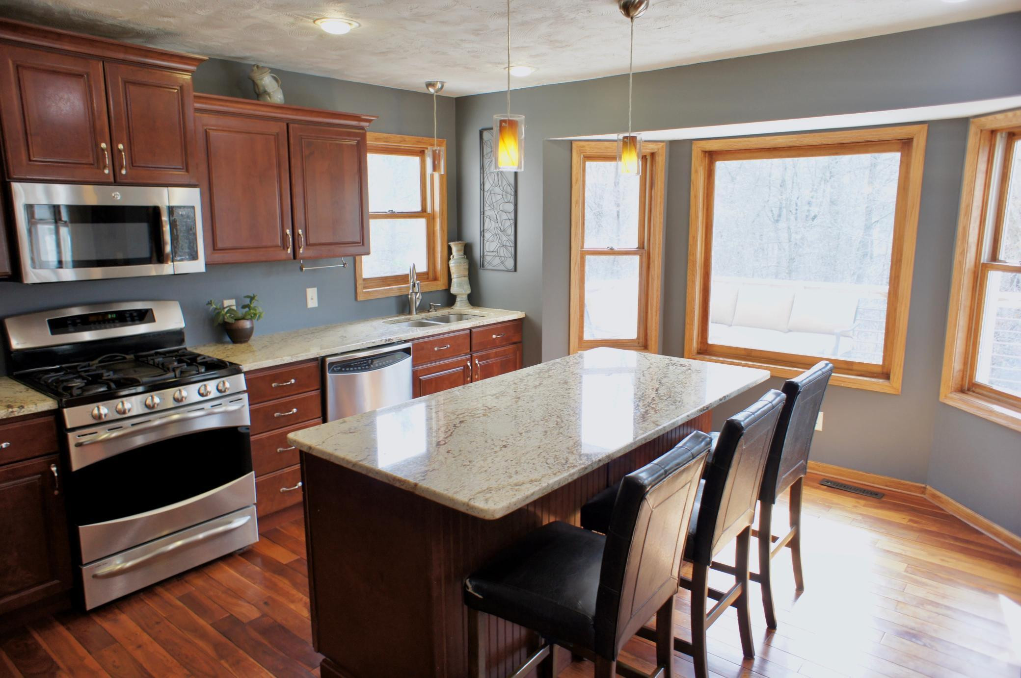 The kitchen overlooks the rear deck and landscaped grounds.