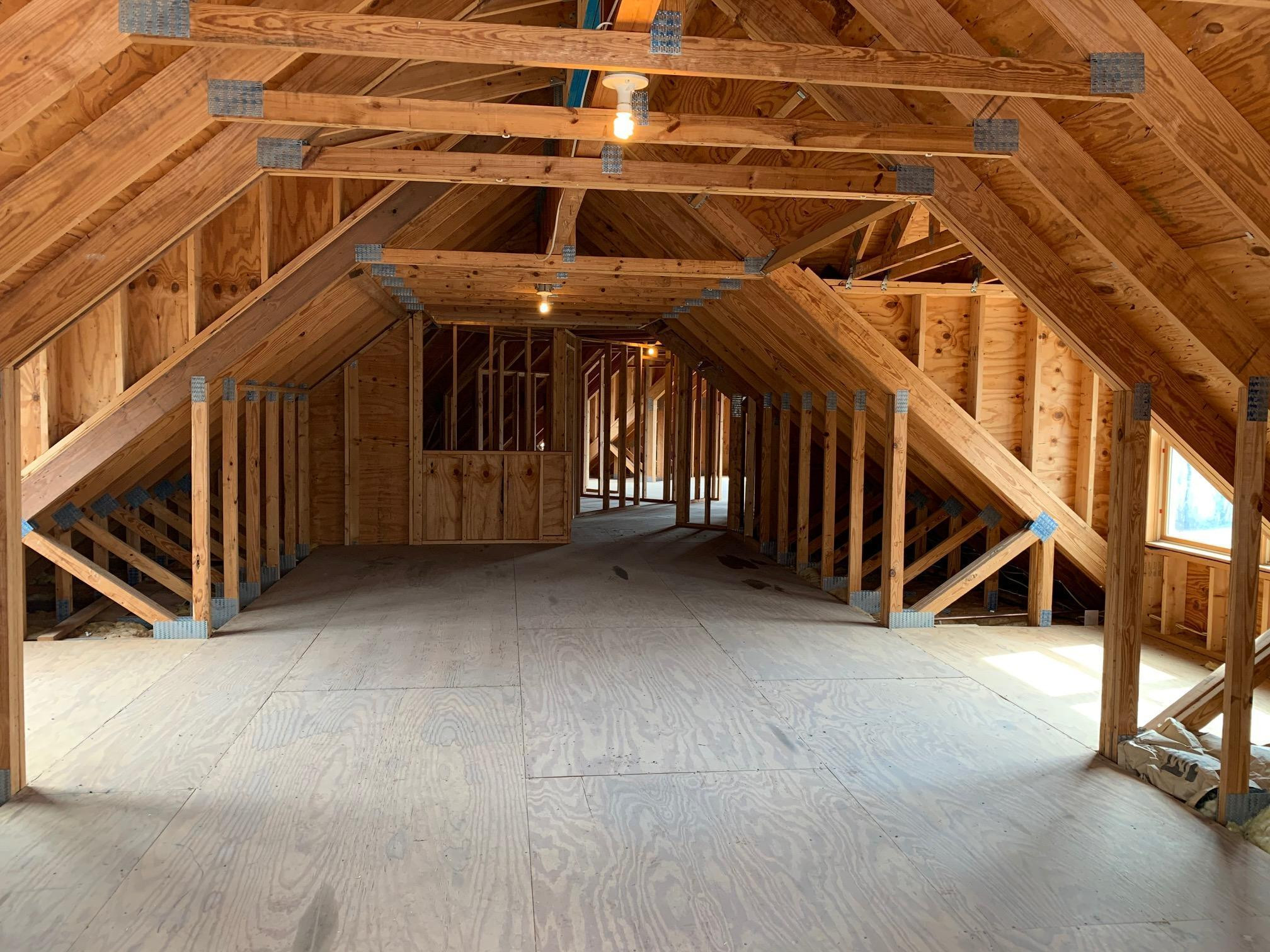 A view of the 1500 square foot bonus potential that is just upstairs from the wonderful garage space. Can you say: Man Cave, Barndominium, ADU, home business office? Who knows what it's future may hold.